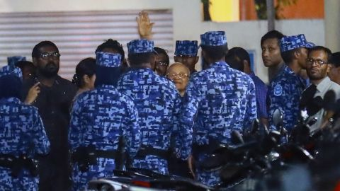 Policemen arrest former Maldives president and opposition leader Maumoon Abdul Gayoom on February 6.