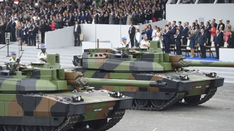 Tanks parade past guests including US President Donald Trump on Bastille Day, 2017.