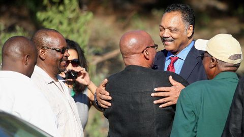 Zuma greets American civil-rights activist Jesse Jackson at a ceremony in Bloemfontein, South Africa, in January 2012.