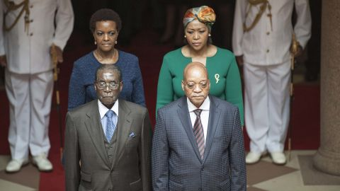 """Zuma and his wife Thobeka Mabhija, right, pose with then Zimbabwean President <a href=""""http://edition.cnn.com/2013/07/31/africa/gallery/robert-mugabe/index.html"""" target=""""_blank"""">Robert Mugabe</a> and his wife, Grace, as they meet in Pretoria in April 2015."""