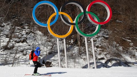 PYEONGCHANG-GUN, SOUTH KOREA - FEBRUARY 04:  A skier goes past the Olympic rings at the Jeongseon Alpine Centre prior to the PyeongChang 2018 Winter Olympic Games on February 4, 2018 in Pyeongchang-gun, South Korea.  (Photo by Ezra Shaw/Getty Images)