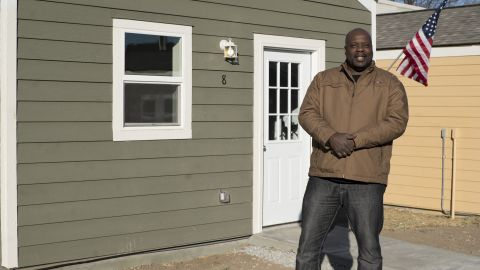 Marvin Gregory, a veteran of the US Army and Coast Guard, stands in front of his new home.