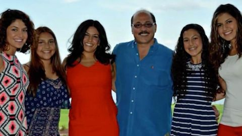 A family photo of Amer Adi with his wife and daughters.