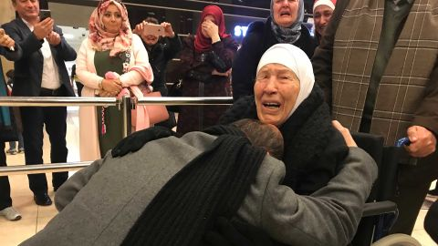 Amer Adi falls to his knees as he reunites with his mother for the first time in 20 years.