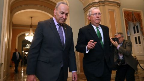 WASHINGTON, DC - FEBRUARY 07:  Senate Minority Leader Charles Schumer (D-NY) (L) and Senate Majority Leader Mitch McConnell (R-KY) walk side-by-side to the Senate Chamber at the US Capitol February 7, 2018 in Washington, DC.(Chip Somodevilla/Getty Images)