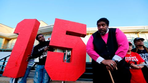 MEMPHIS, TN - APRIL 04:  The Rev. William J. Barber II (R) stands outside the National Civil Rights Museum following a march from City Hall to the museum by Fight for $15 supporters on April 4, 2017 in Memphis, Tennessee. About 1,000 people marched through downtown Memphis from City Hall to the National Civil Rights museum on the 49th anniversary of Dr. Martin Luther King, Jr.'s assassination. (Photo by Mike Brown/Getty Images)