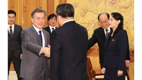 South Korean President Moon Jae-in, left, shakes hands with Ri Son Gwon, North Korea's chief negotiator, as Kim Yo Jong, right, sister of North Korean leader Kim Jong Un, and Kim Yong Nam, North Korea's nominal head of state, stand during a meeting Saturday at the presidential palace.