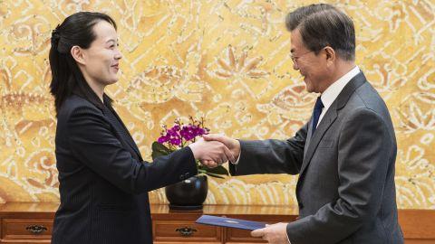 South Korean President Moon Jae-in, right, shakes hands with Kim Yo Jong.