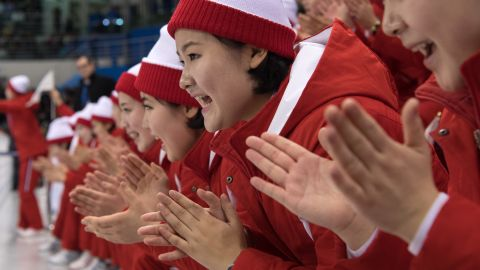 North Korean cheerleaders clap enthusiastically during the unified team's ice hockey match against Switzerland.
