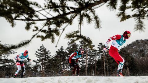Cross-country skiers compete in the men's 15km + 15km skiathlon race.