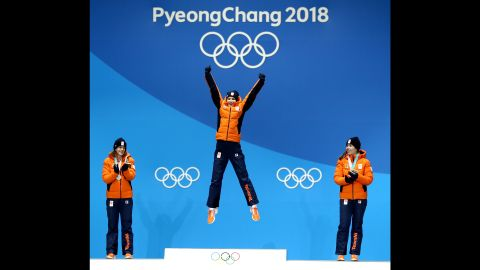Gold medallist Carlijn Achtereekte of the Netherlands, center, celebrates on the podium with silver medalist Ireen Wust  and bronze medalist Antoinette de Jong during the ceremony for the woman's speed skating 3000m.