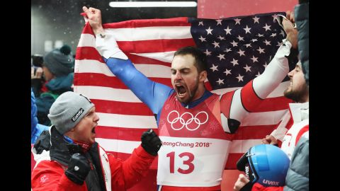 Silver medalist Chris Mazdzer celebrates after capturing the first-ever men's singles luge medal for the United States.
