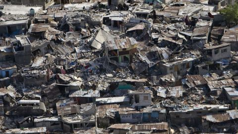 Houses in a poor neighborhood sit destroyed after an earthquake on January 13, 2010 in Port-au-Prince, Haiti.