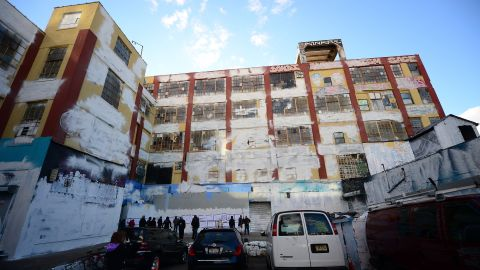 """New York's graffiti iconic spot """"5Pointz"""" stands defaced with white paint covering most of the art work, after the building was painted white in New York, November 19, 2013. 5Pointz, a renowned heaven for urban graffiti artists, is set to be demolished by the end of the year to make way for luxury appartments. AFP PHOTO/Emmanuel Dunand        (Photo credit should read EMMANUEL DUNAND/AFP/Getty Images)"""