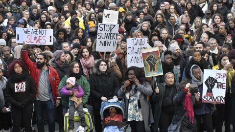 Protestors attend a demonstration in Stockholm, Sweden, in November 2017, against slavery in Libya,