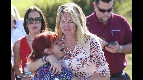 """Parents wait for news after a shooting at Marjory Stoneman Douglas High School in Parkland, Florida, on Wednesday, February 14.<a href=""""https://www.cnn.com/2018/02/14/us/florida-high-school-shooting/index.html"""" target=""""_blank""""> At least 17 people were killed at the school</a>,  Broward County Sheriff Scott Israel said. The suspect, 19-year-old former student Nikolas Cruz, is in custody, the sheriff said. The sheriff said he was expelled for unspecified disciplinary reasons."""