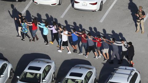 People are brought out of the Marjory Stoneman Douglas High School after the shooting.