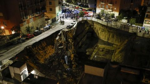 A view of a large sinkhole that opened in a street of a residential area in Rome on Wednesday.