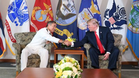 US President Donald Trump meets with Admiral Harry B. Harris, Jr., Commander, US Pacific Command, in Aiea, Hawaii, on November 3, 2017. / AFP PHOTO / JIM WATSON        (Photo credit should read JIM WATSON/AFP/Getty Images)