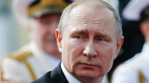 Russian President Vladimir Putin looks on as he attends a ceremony for Russia's Navy Day in Saint Petersburg on July 30, 2017. President Vladimir Putin oversaw a pomp-filled display of Russia's naval might as the Kremlin paraded its sea power from the Baltic Sea to the shores of Syria.  Some 50 warships and submarines were on show along the Neva River and in the Gulf of Finland off the country's second city of Saint Petersburg after Putin ordered the navy to hold its first ever parade on such a grand scale.  / AFP PHOTO / POOL / Alexander Zemlianichenko        (Photo credit should read ALEXANDER ZEMLIANICHENKO/AFP/Getty Images)