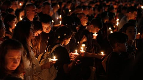 Thousands of mourners attend a candlelight vigil for victims of the Marjory Stoneman Douglas High School shooting in Parkland, Florida on February 15, 2018.A former student, Nikolas Cruz, opened fire at the Florida high school leaving 17 people dead and 15 injured. / AFP PHOTO / RHONA WISERHONA WISE/AFP/Getty Image