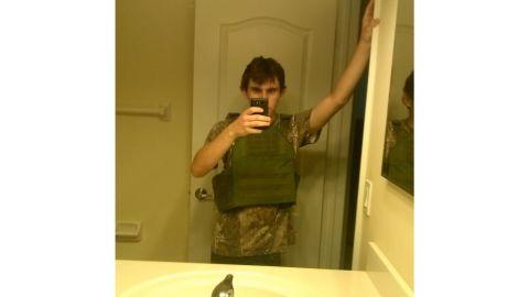 Nikolas Cruz modeling his body armor.
