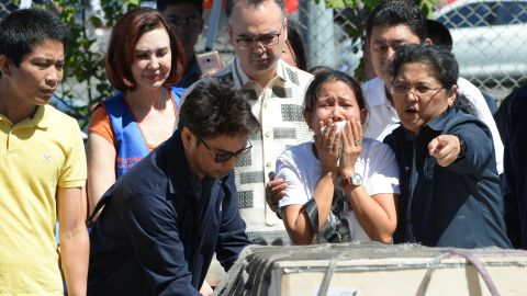 Jessica, sister of Filipina overseas worker Joanna Demafelis, cries near the casket shortly after its arrival in Manila on February 16.