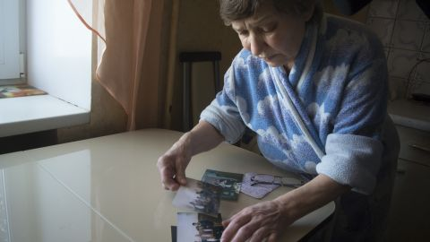 Farkhanur Gavrilova looks at the photos of her son, believed killed in US airstrikes in Syria.