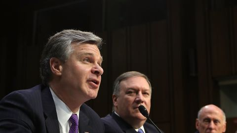 WASHINGTON, DC - FEBRUARY 13:  (L-R) Federal Bureau of Investigation Director Christopher Wray, Central Intelligence Agency Director Mike Pompeo and Director of National Intelligence Dan Coats testify before the Senate Intelligence Committee in the Hart Senate Office Building on Capitol Hill February 13, 2018 in Washington, DC. The intelligence chiefs were called to testify to the committee about 'world wide threats.'  (Photo by Chip Somodevilla/Getty Images)