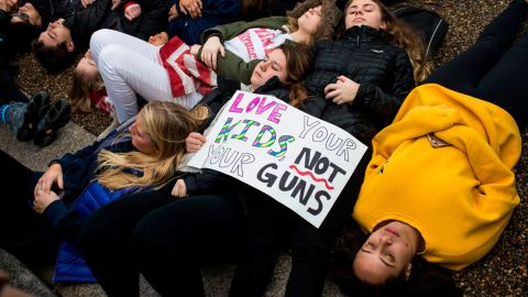 """WASHINGTON, DC - FEBRUARY 19: Demonstrators lie on the ground during a """"lie-in"""" demonstration supporting gun control reform near the White House on February 19, 2018 in Washington, DC. According to a statement from the White House, """"the President is supportive of efforts to improve the Federal background check system."""", in the wake of last weeks shooting at a high school in Parkland, Florida. (Photo by Zach Gibson/Getty Images)"""