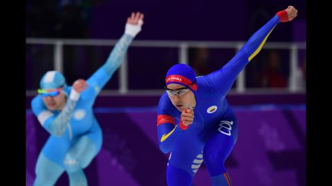 Colombian speedskater Pedro Causil, right, competes in the 500 meters.
