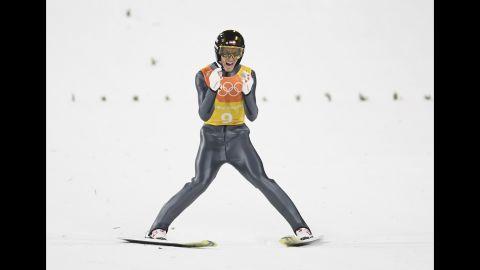 Austrian ski jumper Gregor Schlierenzauer lands during the team event.