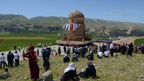 """Locals watch the tomb of Zenyel Bey transported in May 2017. The 15th century monument, dedicated to a figure from the Ak Koyunlu, a Turkmen tribe, was moved away from ground at risk of flooding due to a hydroelectric dam project in southeast Turkey. The Ak Koyunlu, which translates as """"White Sheep,"""" once ruled Anatolia, Azerbaijan and northern Iraq in the 14th to early-16th century AD."""