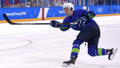 Slovenia's Ziga Jeglic scores the game-winning goal against Slovakia in the men's preliminary round ice hockey match between Slovakia and Slovenia during the Pyeongchang 2018 Winter Olympic Games.