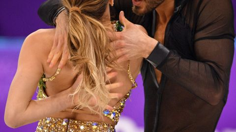 France's Guillaume Cizeron performs with France's Gabriella Papadakis as the back fastening of her costume is undone during the Ice Dance short dance.