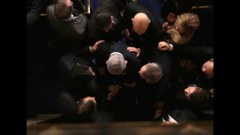 """Netanyahu is greeted by members of US Congress as he arrives to speak in the House chamber in March 2015. He warned that a proposed agreement between world powers and Iran was """"a bad deal"""" that would not stop Tehran from getting nuclear weapons — but would rather pave its way to getting lots of them and leave the Jewish State in grave peril."""