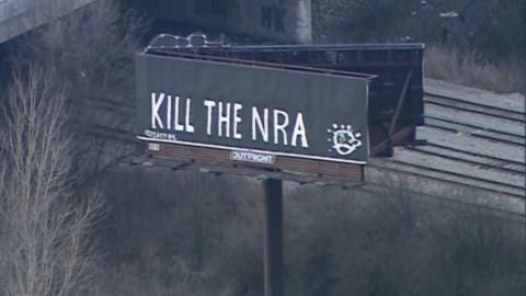 The billboard's owner said the vandals' slogan was replaced with a public service announcement.