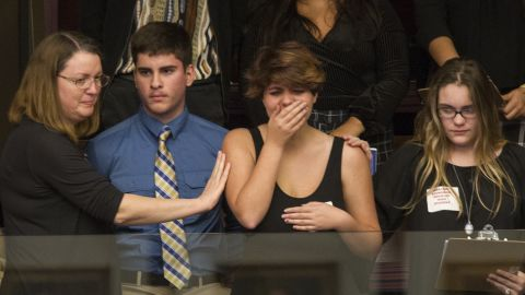 Sheryl Acquaroli, a 16-year-old junior from Marjory Stoneman Douglas High School, is overcome with emotion in the gallery of the House of Representatives after the vote.
