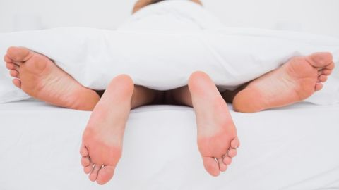 Rear view of a couple having sex in bed; Shutterstock ID 146042159; Job: -