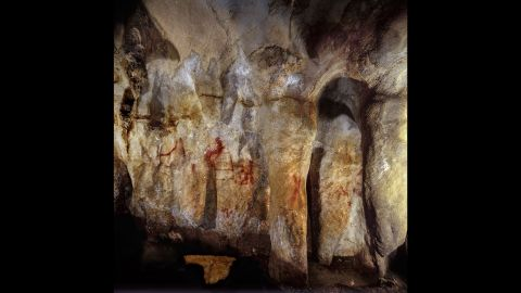 """This wall with paintings is in the La Pasiega Cave in Spain. The ladder shape of red horizontal and vertical lines is more than 64,000 years old<a href=""""https://www.cnn.com/2018/02/22/health/neanderthal-art-symbols-cognition-study/index.html""""> and was made by Neanderthals</a>."""