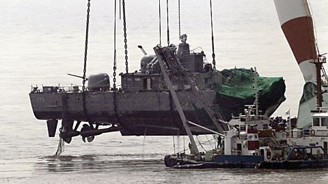 A giant floating crane lifts the stern of the 1,200-tonne sunken Cheonan to place it on a barge, before returning it to South Korea, April 15, 2010.