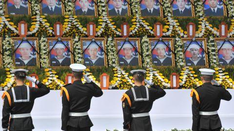 South Korean sailors salute images of their fallen comrades during a Cheonan memorial service in Seoul, April 25, 2010.