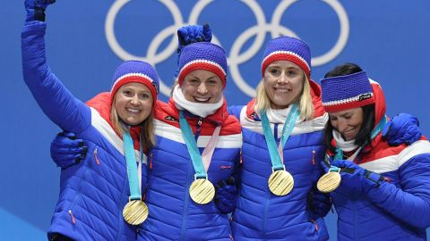 Norway's gold medallists Ingvild Flugstad Oestberg, Astrid Uhrenholdt Jacobsen, Ragnhild Haga and Marit Bjeorgen pose on the podium during the medal ceremony for the cross country women's 4x5km relay.