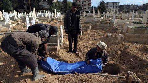 Syrians prepare to bury a body in Kafr Batna, in the besieged Eastern Ghouta region, on Thursday.