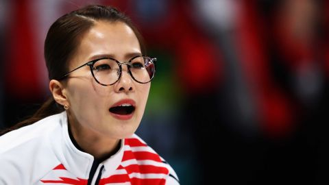 Kim Eun-jung of South Korea competes during the women's curling event.
