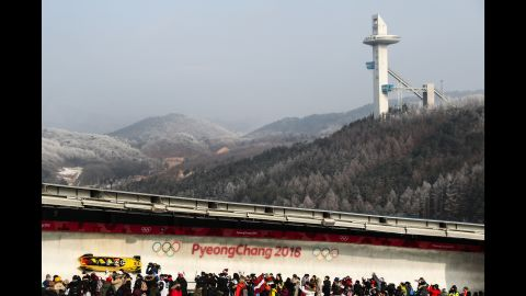 The bobsled piloted by Germany's Nico Walther makes its way down the track. Walther's team finished in a tie for silver.