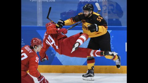 Germany's Felix Schutz, right, checks Russian Yegor Yakovlev in the gold-medal hockey game.