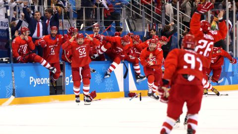 The Olympic athletes from Russia celebrate after winning the men's hockey final. They defeated Germany 4-3 in overtime.