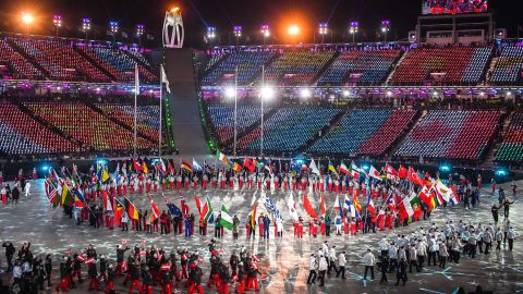 Flagbearers arrive to the closing ceremony.