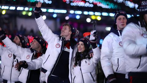 Figure skaters Madison Chock and Evan Bates walk with Team USA during the closing ceremony.